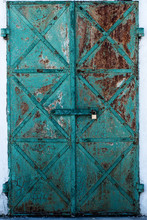 Old Turquoise-colored Doors