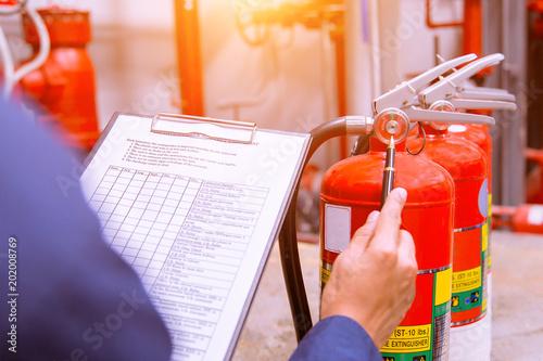 Fotografie, Obraz  Engineer checking Industrial fire control system,Fire Alarm controller, Fire notifier, Anti fire