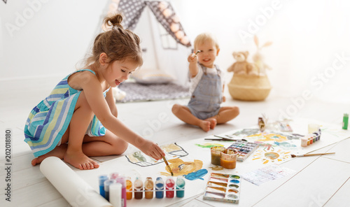 happy funny children paint with paint.
