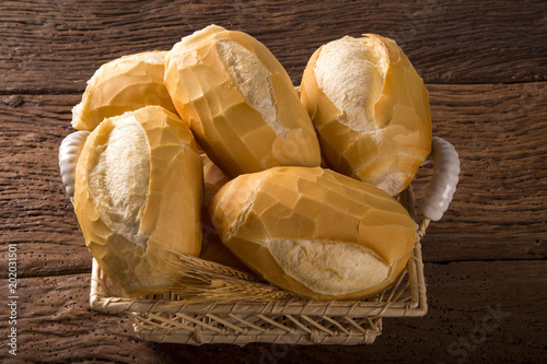 Valokuva Basket of French bread, traditional Brazilian bread on wood background