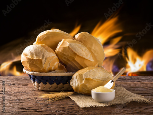 Tela Basket of French bread, traditional Brazilian bread with fire background