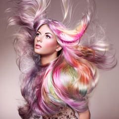 Fototapeta Do fryzjera Beauty Fashion Model Girl with Colorful Dyed Hair. Girl with perfect Makeup and Hairstyle. Model with perfect Healthy Dyed Hair. Rainbow Hairstyles