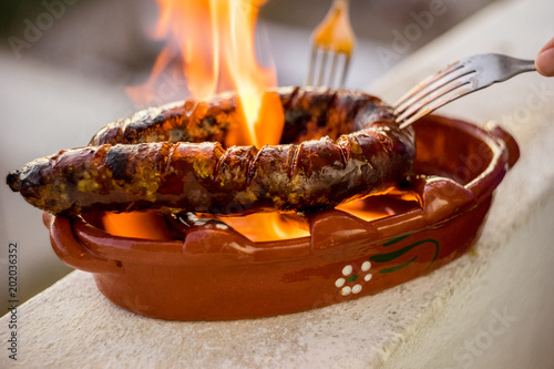 Traditional portuguese chourico or spanish chorizo prepared in a special clay pot