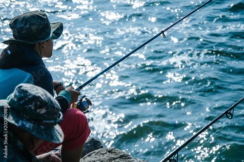 Spoed Foto op Canvas Luchtsport Fisherman on the seashore