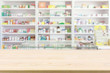 canvas print picture Pharmacy drugstore counter table with blur abstract backbround with medicine and healthcare product on shelves