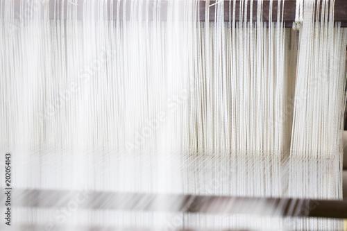 Slika na platnu Closed up of loom with white thread background