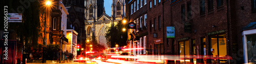 Sundown of central York, UK, with York Minster cathedral on the back. Car traffic trail lights in York, UK
