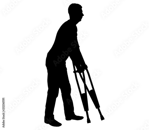 Valokuva  Vector silhouetteof a disabled man with crutches walking