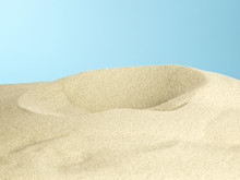 Sand Pile On Blue Background