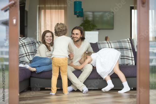 Happy Cheerful Family Playing At Home On Weekend Active Kids
