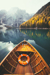FototapetaTraditional rowing boat on a lake in the Alps