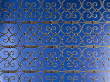 Metal Grate On Blue Background