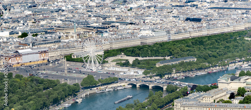 Tuinposter Parijs Aerial view of Concorde square and bridge with Ferris wheel, Obelisk and Tuileries Garden near Louvre museim in Paris, France
