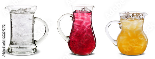 Fototapeta Three pitchers with water, red and orange juice in isolated background obraz