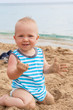 Baby boy playing on the beach