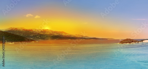 In de dag Oranje Panoramic Sunrise over the sea and famous Greek island Corfu, aerial shot