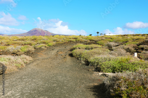 Staande foto Pool Pathway with amazing landscape with crater volcano La Corona on the background, Lanzarote, Canary Islands