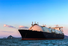 LNG Carrier At Sunset On The Roads.