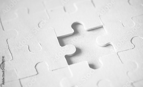 Fotografiet  Macro shot jigsaw puzzle missing solution concept