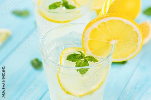 Refreshing drinks for summer, cold  lemonade juice with sliced fresh lemons