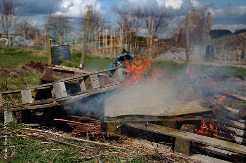 Fényképezés Wooden pallets and general rubbish being burned on an allotment