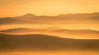 Picturesque sunrise in Tuscany, Italy. Misty morning with light fog shapes magically the hills and valleys of this beautiful tourist location in San Quirico d'Orcia region. Horizontal image
