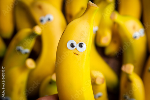 Leinwand Poster funny pack of bananas with eyes
