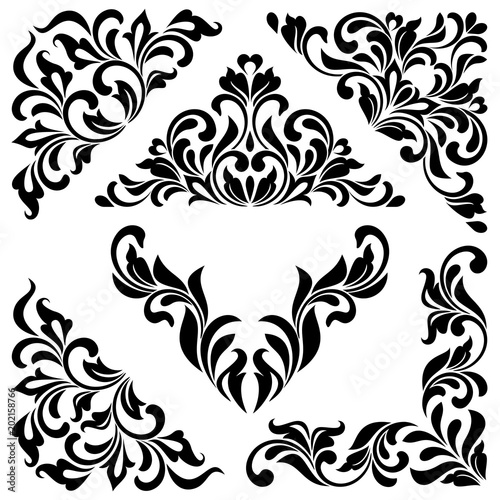 A set of angular ornaments. Ideal for stencil. Ornate tracery of swirls and leaves isolated on white background. Decorative vintage style. Wall mural