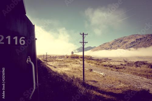 Poster Oceanië Train in Mountain fields landscape, New Zealand