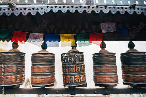Buddhist prayer drums with close-up mantras and colored
