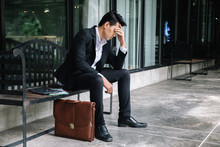 Concept Of Business Failure And Unemployment Problem.An Unemployed Businessman Sits Alone In The Corridor Of An Office. Is Stressed About The Future. Effect From Coronavirus