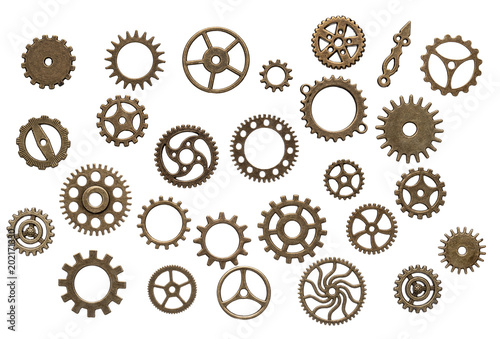 Photo  Set of different brass cog wheels isolated on white background