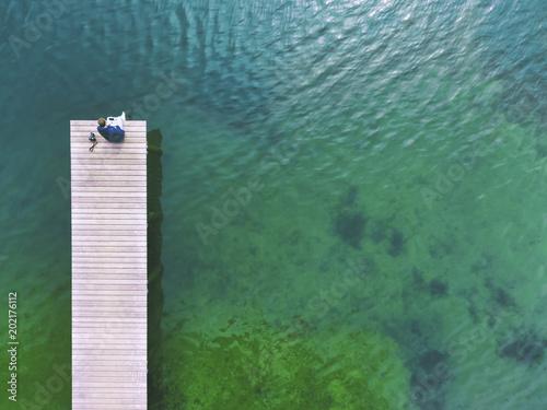 Germany, Bavaria, Chiemsee, man sitting on jetty