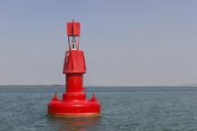 Floating Red Navigational Buoy...