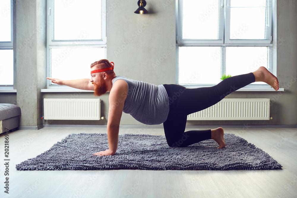 Fototapety, obrazy: Funny man doing yoga