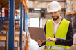 Warehouse worker. Positive smart man wearing uniform while working as a warehouse manager