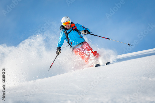 fototapeta na lodówkę Male freeride skier in the mountains off-piste