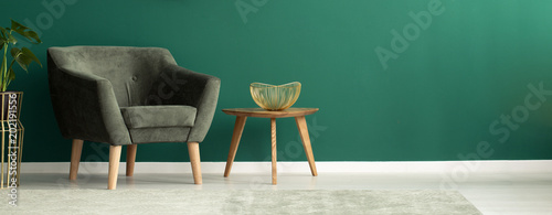 Fototapeta  Comfortable armchair in green interior