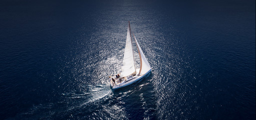 Fototapeta Amazing view to Yacht sailing in open sea at windy day. Drone view - birds eye angle.