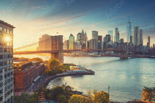 Retro style New York Manhattan with Brooklyn Bridge and Brooklyn Bridge Park in the front Canvas Print