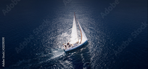 Amazing view to Yacht sailing in open sea at windy day. Drone view - birds eye angle.