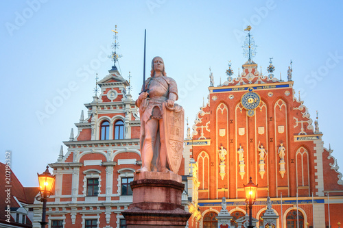 Riga House of Blackheads and Statue of Saint Roland at Dusk