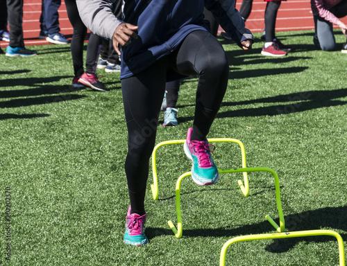 Fotografie, Obraz  Speed work over yellow mini hurdles at practice