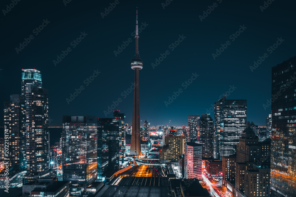 Fototapety, obrazy: Entire futuristic city skyline view of downtown Toronto Canada. Modern buildings, urban architecture, cars travelling. construction and development in a busy city