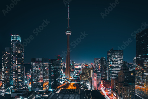 Photo sur Toile Toronto Entire futuristic city skyline view of downtown Toronto Canada. Modern buildings, urban architecture, cars travelling. construction and development in a busy city