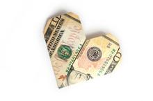 A Ten-dollar Bill Folded In The Shape Of A Heart