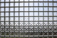 Texture Of Many Shiny Transparent Beautiful Square Thick Glass Tiles With Seams Background