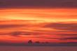 Leinwandbild Motiv Vivid orange sunset over island
