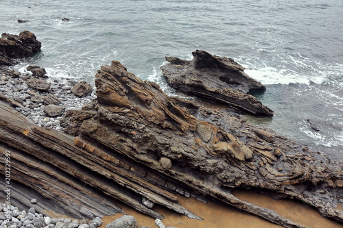 Photo  Rock layers-flysch formation in Senaia Kala cove-foot Gaztelugatxe islet