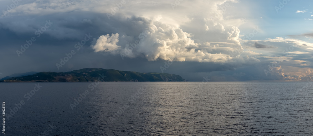 Fototapeta Sea landscape with stormy cloudy sky and Zakynthos island in background. Ionian Sea
